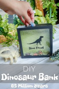 A shadow box bank with a dinosaur image and the words dino fund on it.